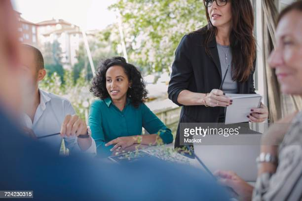 Business people planning strategy in portable office truck