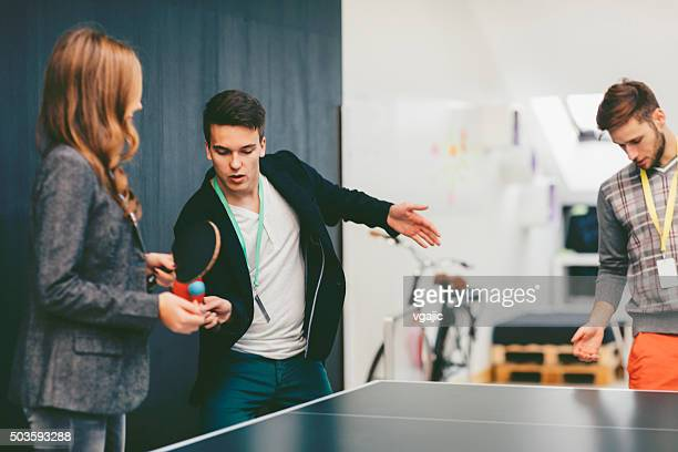 Business People Playing Table Tennis In Their Office