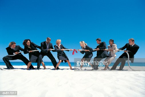 Business People Playing Tug-of-War on the Beach : Stock Photo