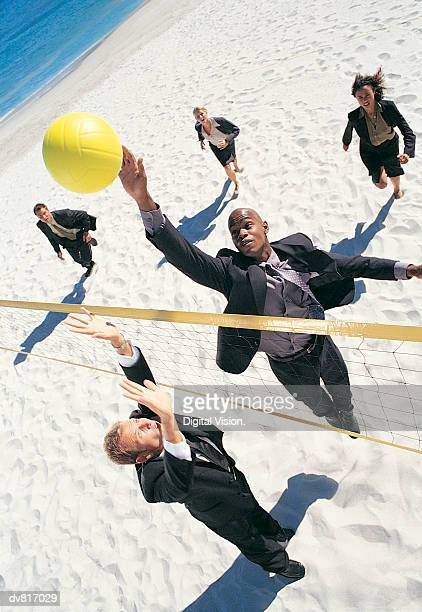 Business People Playing Volleyball