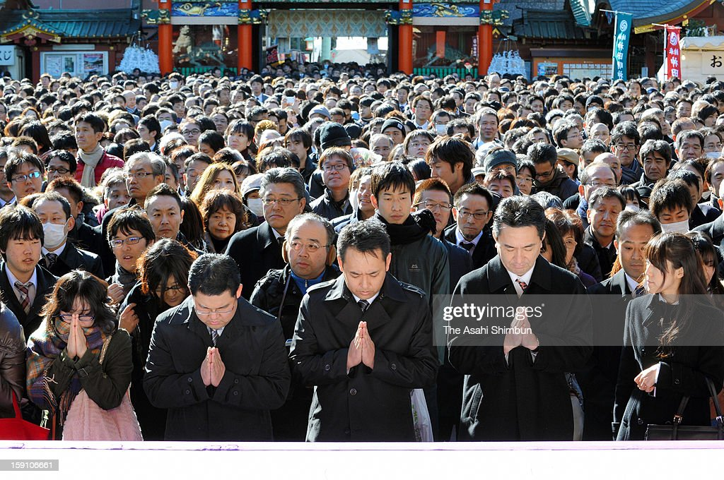 Business people pray for the prosperous business at Kanda Myojin Shrine on the first business day of the year on Janaury 4, 2012 in Tokyo, Japan.