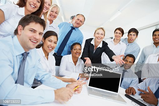 Business people presenting a blank laptop screen : Stock Photo