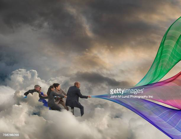 Business people pulling multicolor waves of information