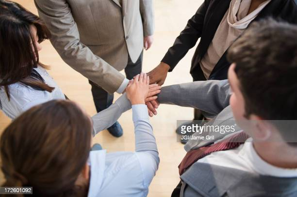 Business people putting hands in circle