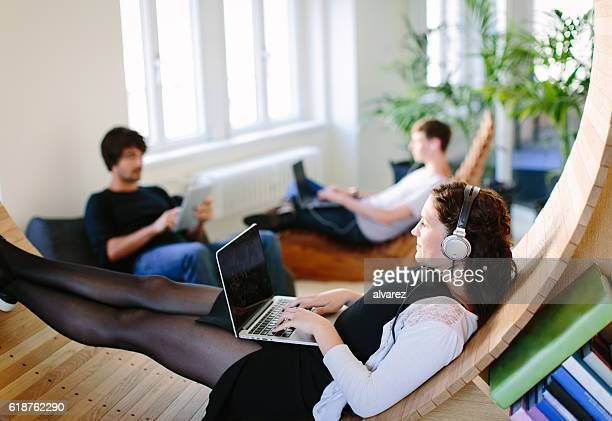 Business people relaxing at recreation room in office