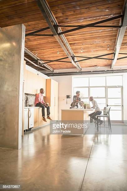 Business people relaxing in office kitchen