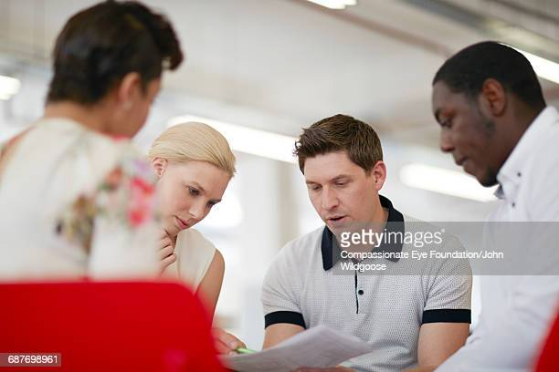 Business people reviewing proofs in office