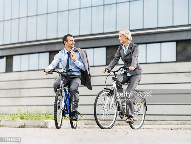 Business people riding bicycles.