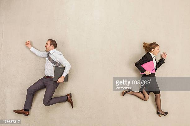 Business people running in opposite direction