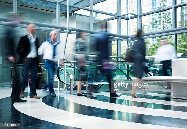 Business People Rushing in Lobby, Motion Indoors