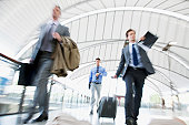 Business people rushing in train station
