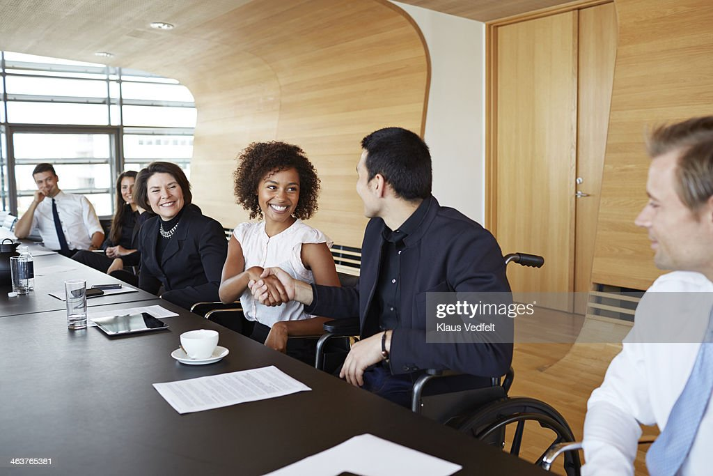Business people shaking hands at meeting : Stock Photo