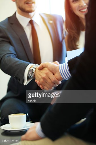 Business people shaking hands, finishing up a meeting. : Foto stock
