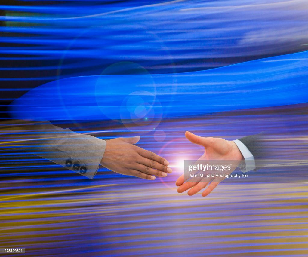 Business people shaking hands on blurred background : Stock Photo