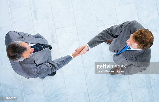 Business people shaking hands