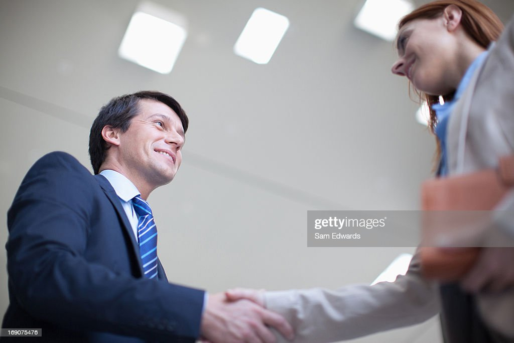 Business people shaking hands together : Stock Photo