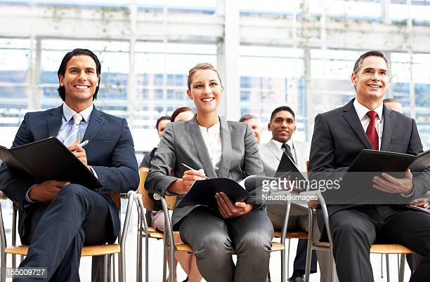 Business People Sitting at a Conference