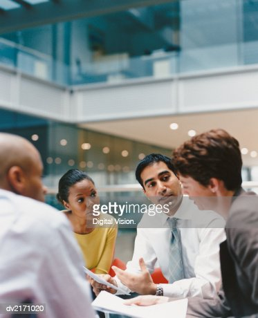 Business People Sitting in an Office Building Having a Meeting : Stock Photo
