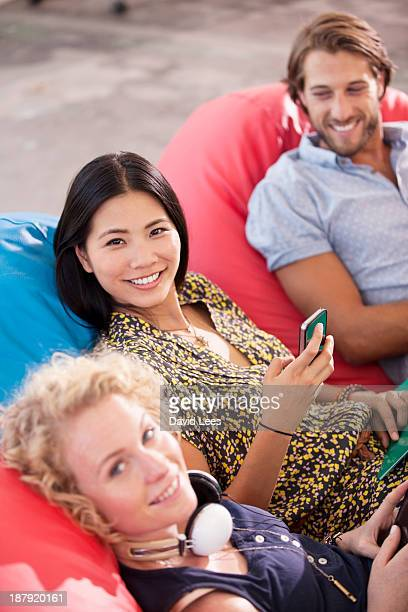 Business people sitting in bean bag chairs