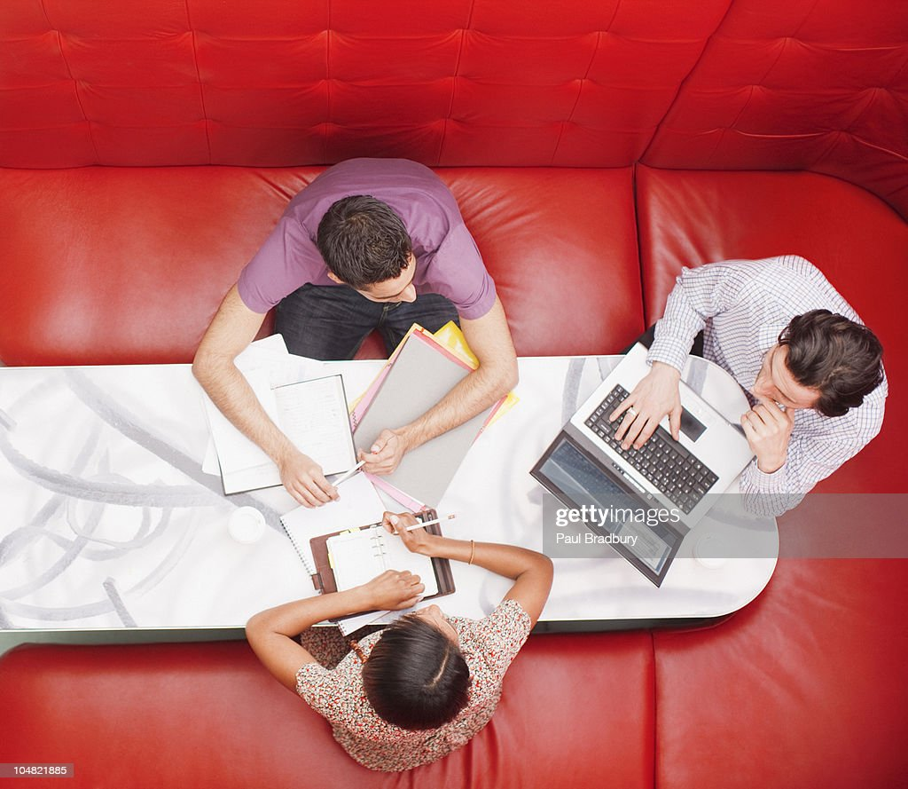 Business people sitting in booth having a meeting : Stock Photo