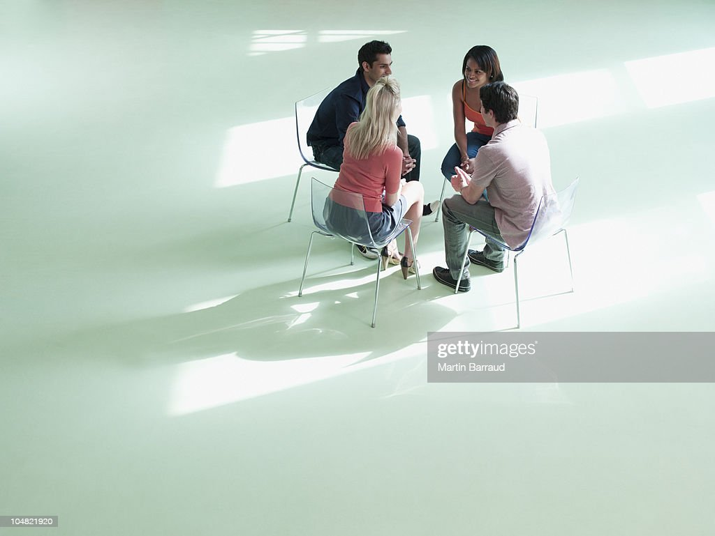 Business people sitting in circle : Stock Photo