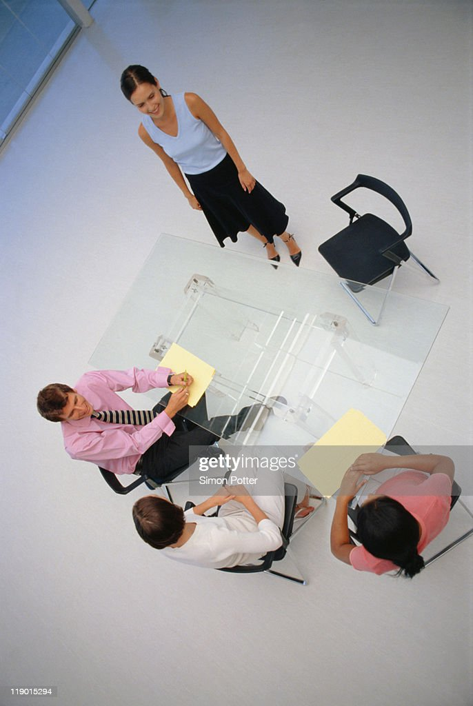 Business people sitting in meeting : Stock Photo