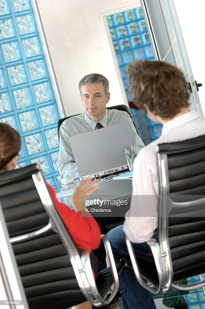 Business people sitting in office : Stock Photo