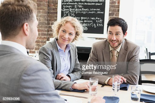 Business people sitting in restaurant : Stock Photo