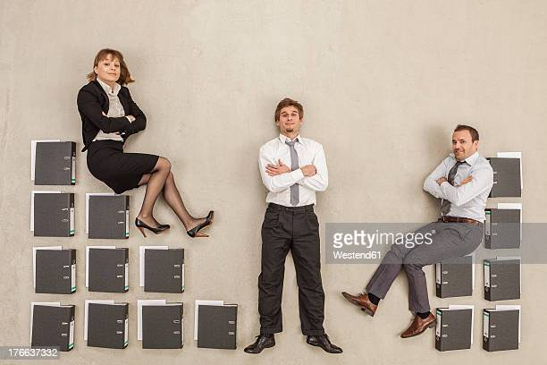 Business people sitting on file stairs in office break