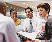 Business People Sitting Talking in an Office Building