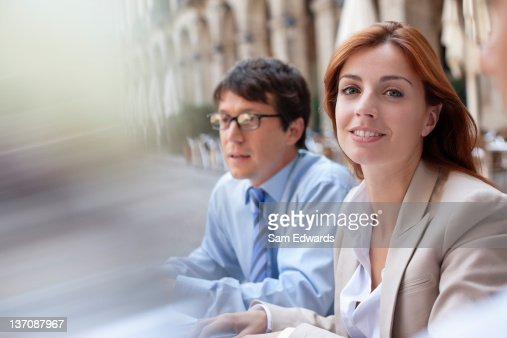 Business people sitting together outdoors : Stock Photo