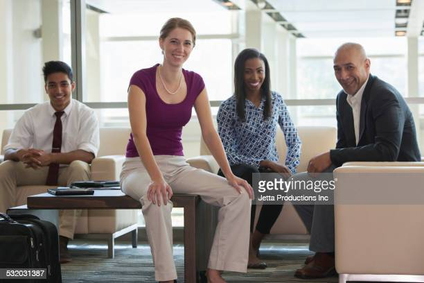 Business people smiling in office lobby