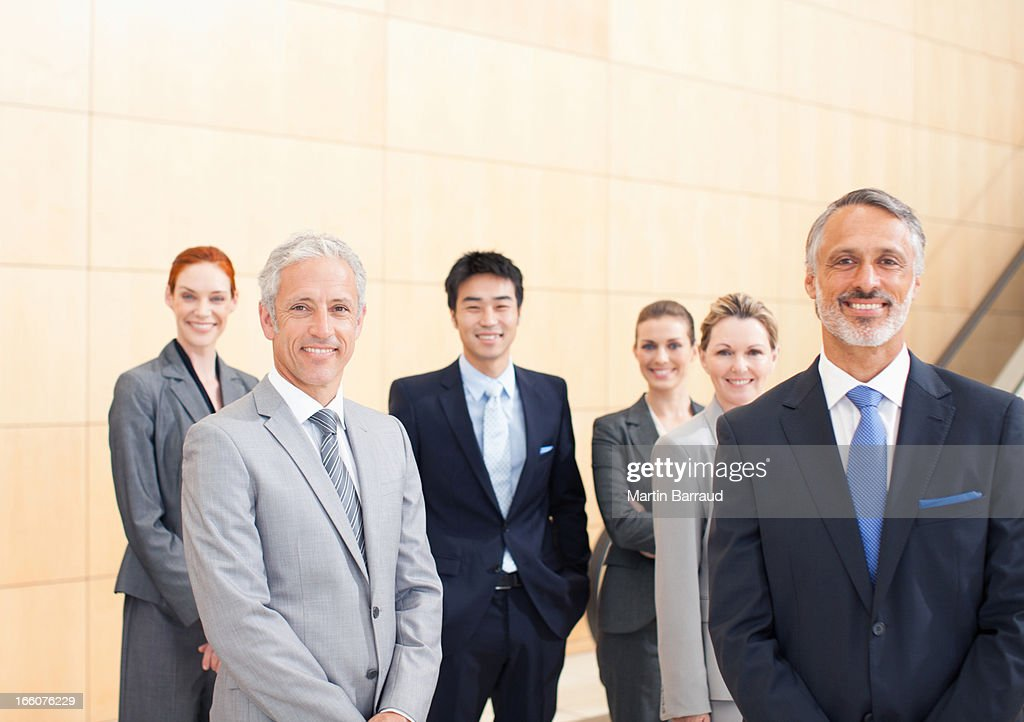Business people smiling : Stock Photo