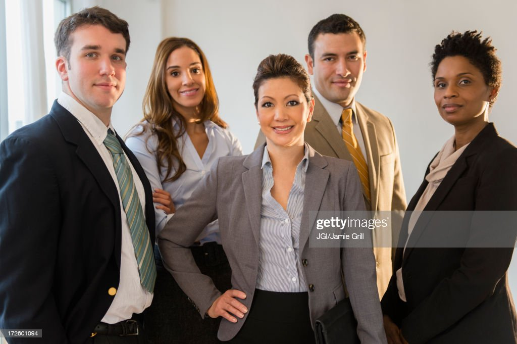 Business people smiling together in office : Stock Photo