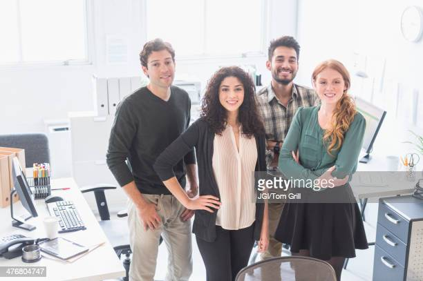Business people smiling together in office