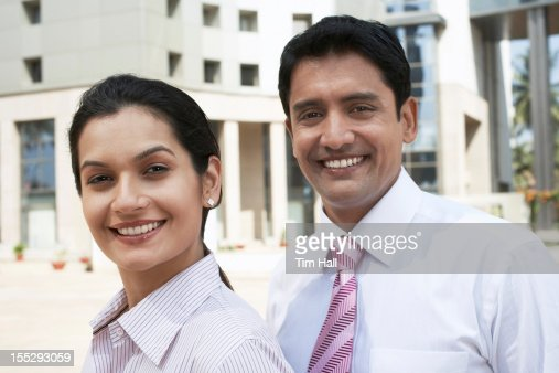 Business people smiling together : Stockfoto