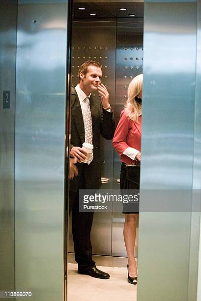Business people standing in elevator with the doors closing