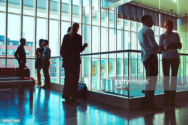 Business people standing in the office building lobby