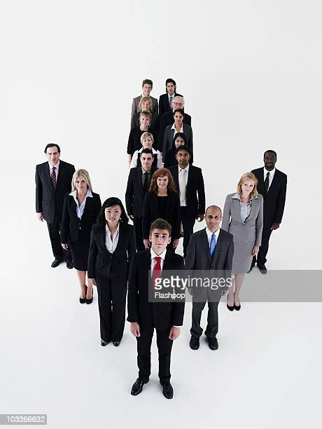 Business people standing in the shape of an arrow