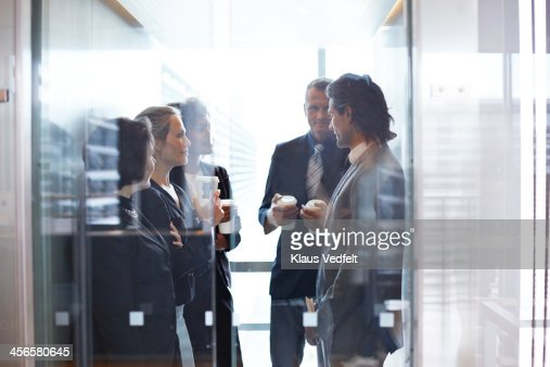 Business people standing together in elevator : Stock Photo