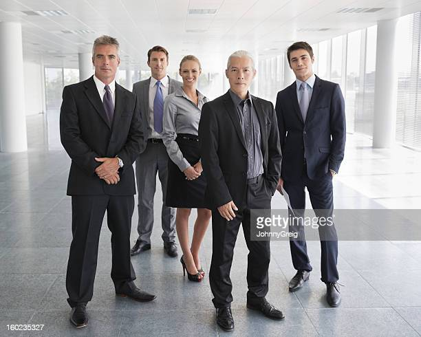 Business People Standing Together In Office Lobby