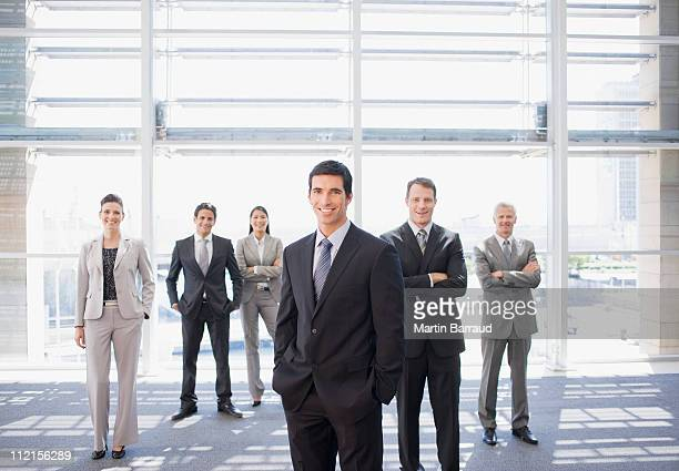 Business people standing together in office