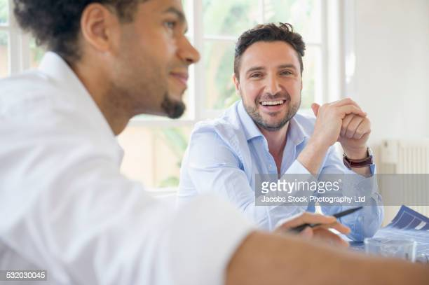 Business people talking at conference table