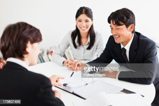 Business people talking at desk : Stock Photo