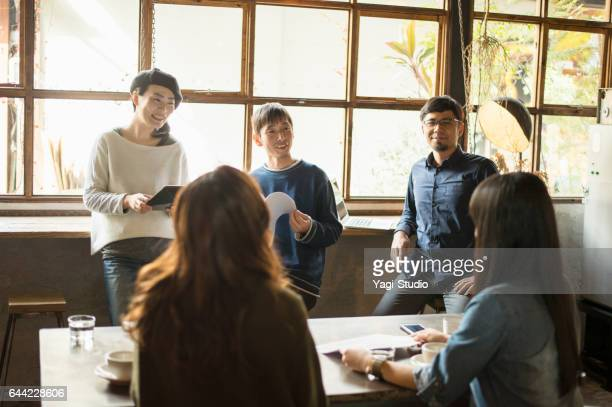 Business people talking at meeting in cafe