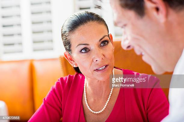 Business people talking at restaurant