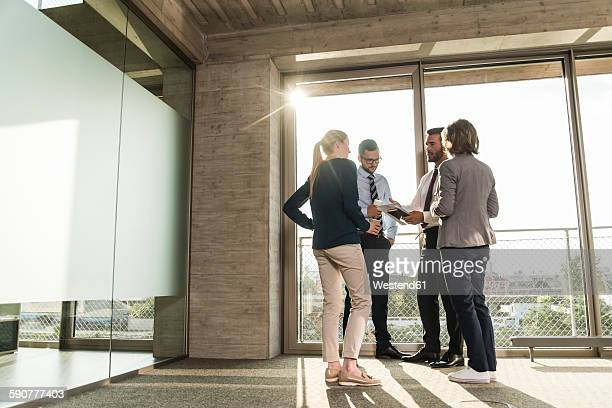Business people talking at the window