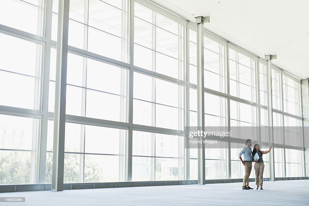 Business people talking in lobby : Stock Photo