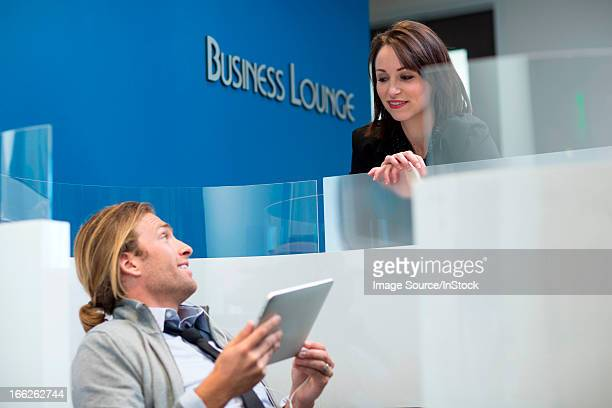Business people talking in lounge