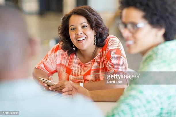 Business people talking in meeting in board room